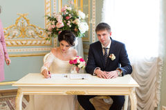 Young couple signing wedding contract Royalty Free Stock Photos