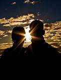 Young Couple Silhouette. A young couple in love photographed against the setting sun royalty free stock photo