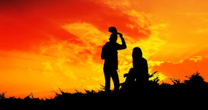 Young couple silhouette looking sunset Royalty Free Stock Photo
