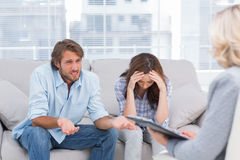 Young couple sit on the couch of the therapist Stock Images