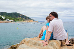 Young couple sit near the sea Royalty Free Stock Images