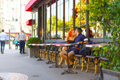 Young couple sit in Parisian cafe Stock Images
