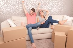 Young couple siting on sofa Royalty Free Stock Photo