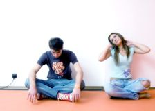 Young Couple Sitting. A young couple sitting on the floor royalty free stock images