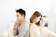 Young Couple sitting back to back during conflict. Young asian Couple sitting back to back during conflict Royalty Free Stock Photos