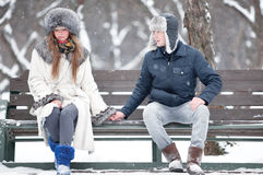 Young couple sitting on a bench Royalty Free Stock Photo