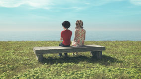 Young couple sitting on the bench stock photography
