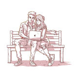Young couple sitting on a bench and listen to music Royalty Free Stock Photo
