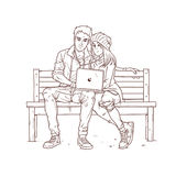 Young couple sitting on a bench and listen to music Royalty Free Stock Image