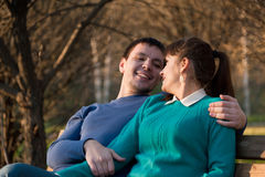 Young couple sitting on bench Stock Image