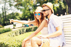 Young couple sitting on a bench royalty free stock image