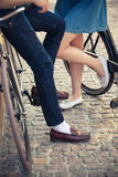 Young couple sitting on a bicycle opposite the Stock Photography