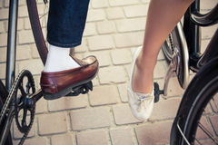 Young couple sitting on a bicycle opposite the Stock Photos