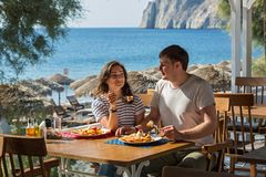 Young couple sitting in a cafe near the sea Stock Photo