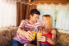 Young couple sitting in a camper van Royalty Free Stock Photo
