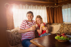 Young couple sitting in a camper van Royalty Free Stock Images