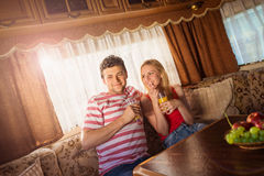 Young couple sitting in a camper van Royalty Free Stock Photography