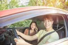 Young couple sitting in the car Royalty Free Stock Images