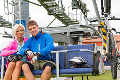 Young couple sitting chair lift waiting departing Royalty Free Stock Photo