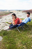 Young Couple Sitting In Chairs On Camping Trip Stock Photos