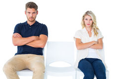 Young couple sitting in chairs not talking during argument Royalty Free Stock Photos