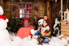 Young Couple Sitting on Christmas Decorated House Royalty Free Stock Photo