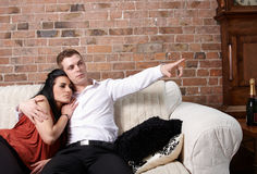 A young couple sitting close Royalty Free Stock Photos
