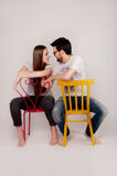 Young couple sitting close on the floor and holding hands Royalty Free Stock Photos