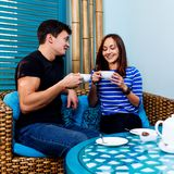 Young couple sitting on the couch in spa salon. royalty free stock photo