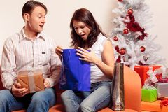 Young Couple Exchanging Christmas Gifts Stock Photos