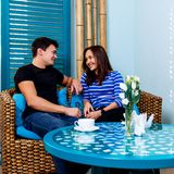Young couple sitting on the couch in spa salon. stock photography