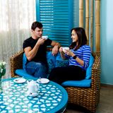 Young couple sitting on the couch in spa salon. royalty free stock images