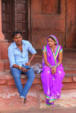 Young couple sitting in the courtyard of Jama Masjid in Fatehpur Royalty Free Stock Image