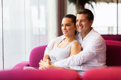 Young couple sitting Stock Image
