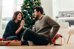 Young couple celebrating Christmas at home. Stock Photos