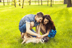 Young Couple sitting with dog Stock Photos