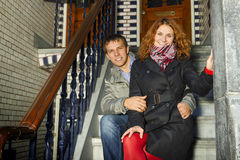 Young couple sitting on a Dutch porch outdoors in autumn Stock Photo