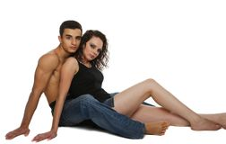 Young couple sitting on the floor Stock Images