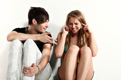 Young couple sitting on the floor, Royalty Free Stock Photos