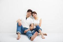 Young Couple Sitting On Floor Royalty Free Stock Photography