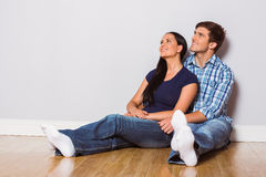 Young couple sitting on floor Stock Photos