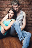Young couple sitting on the floor Stock Image