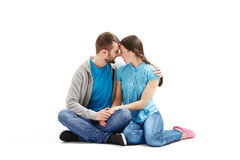 Young couple sitting on the floor Stock Photos