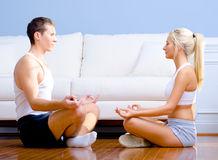 Young Couple Sitting on Floor Meditating Royalty Free Stock Photo