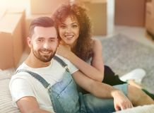 Young couple sitting on the floor in a new apartment Stock Image