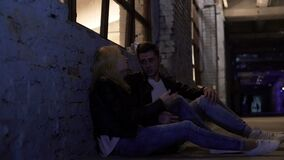 Young couple sitting on floor, talking about problems and hugging, support. Stock footage stock footage
