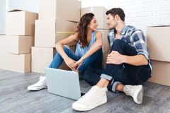 Young couple sitting on the floor of their new apartment Royalty Free Stock Image