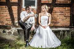 Young couple sitting in front of the house stock photos