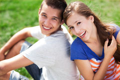 Young couple sitting on grass Royalty Free Stock Image