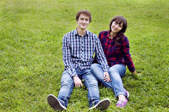 Young couple sitting on grass Stock Image